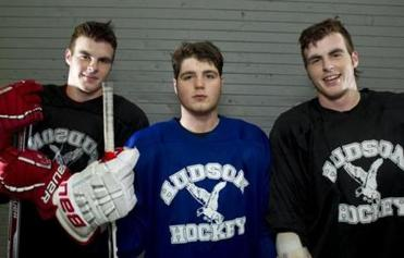 2/20/12 Marlborough, MA (L to R) Brian Fahey, Tyler Kirby, and Thomas Fahey pose for a picture after the practice The Hudson Boy's Hockey Team held a practice before starting the playoffs with a 16-1-1 record